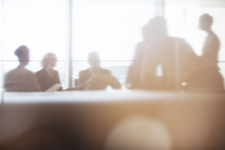 Silhouette of business people in meeting
