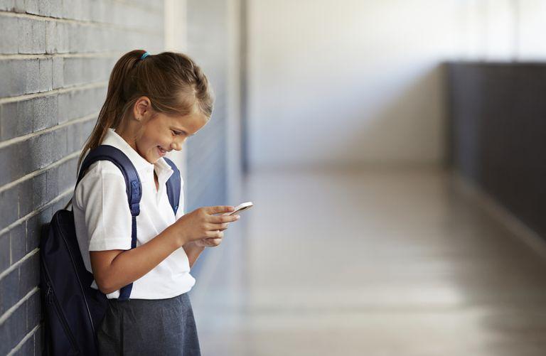 Schoolgirl Looking at Smartphone