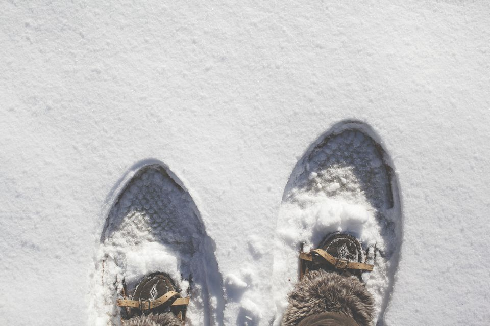 Overhead view of a man's snowshoes, Maine, America, USA