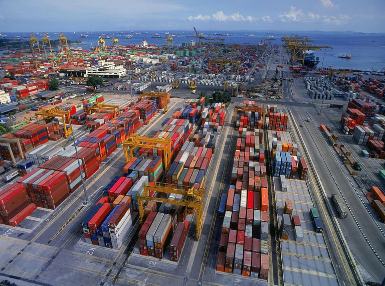 Container ships are unloaded at the Port of Singapore. The Port of Singapore is the world's busiest port in terms of total shipping tonnage moving through it, and second only to Shanghai in terms of total cargo tonnage moved.