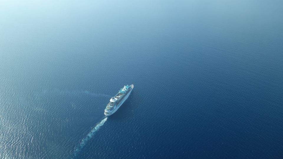 Aerial View Of Cruise Ship Sailing On Sea