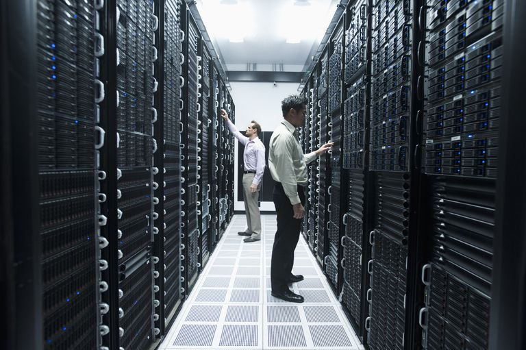 Businessmen working in server room
