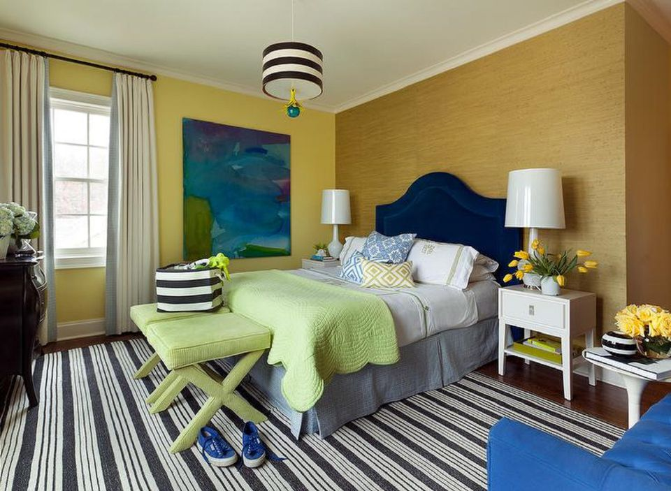Gold and blue bedroom with striped rug