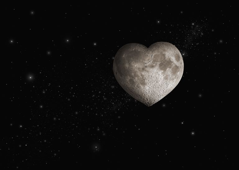 Heart-shaped moon in space