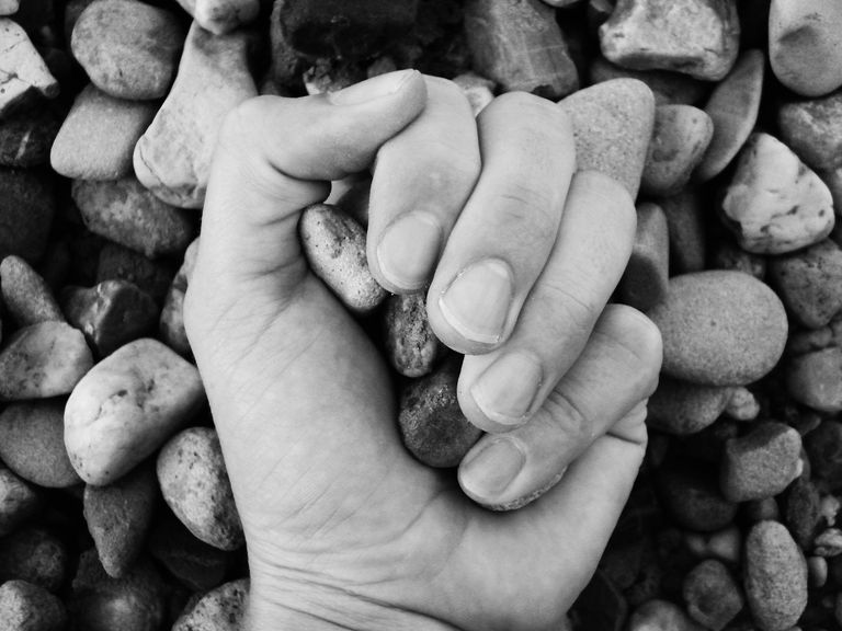 A hand full of stones