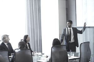 Businessman giving presentation to colleagues in conference room