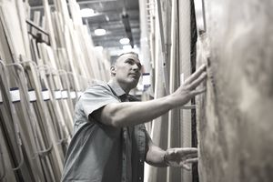 Man inspecting wood at home improvement store