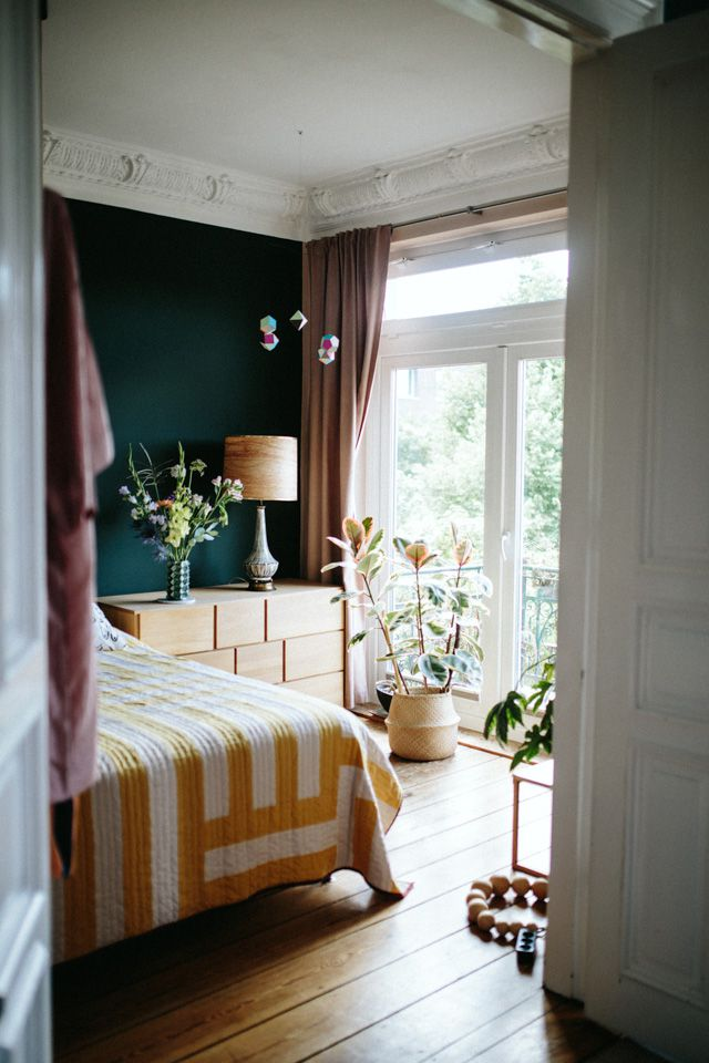 dark room with bright yellow bedspread