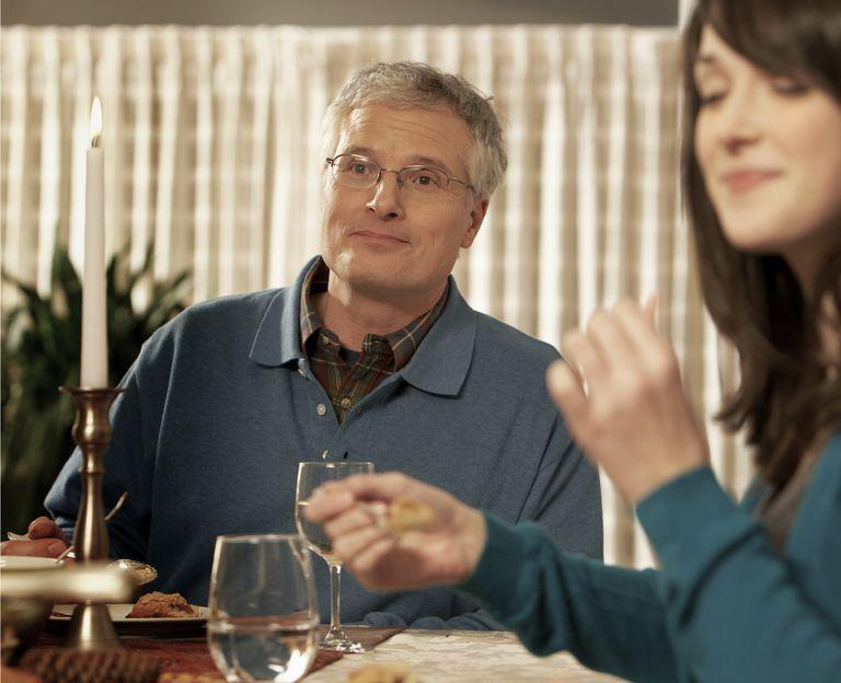 Man & woman eating at table