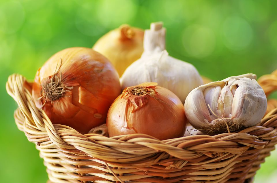 Close-up of Garlic and Onions in Wicker Basket