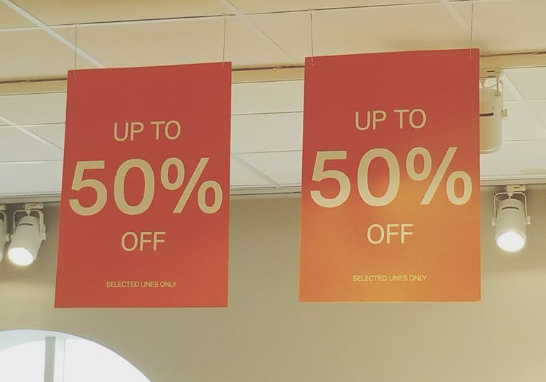 Sale signs hanging from the ceiling.