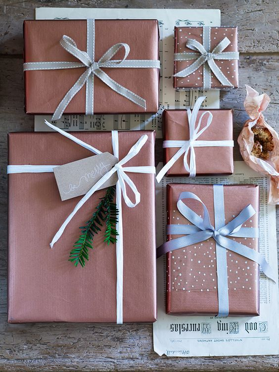 Gifts wrapped in metallic copper wrapping paper