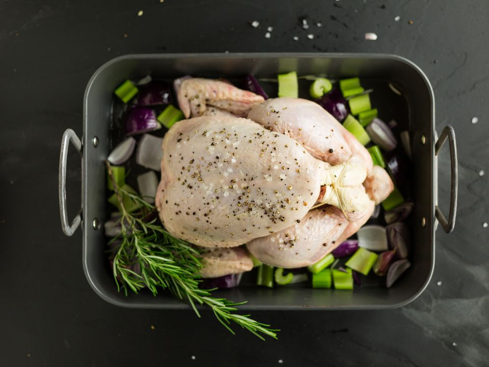 raw chicken in roasting pan