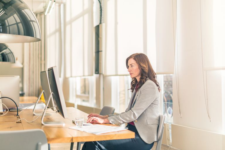 Woman in office on computer