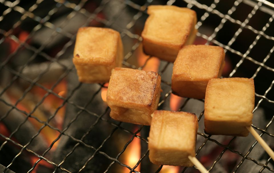 Grilled tofu over charcoal, close-up