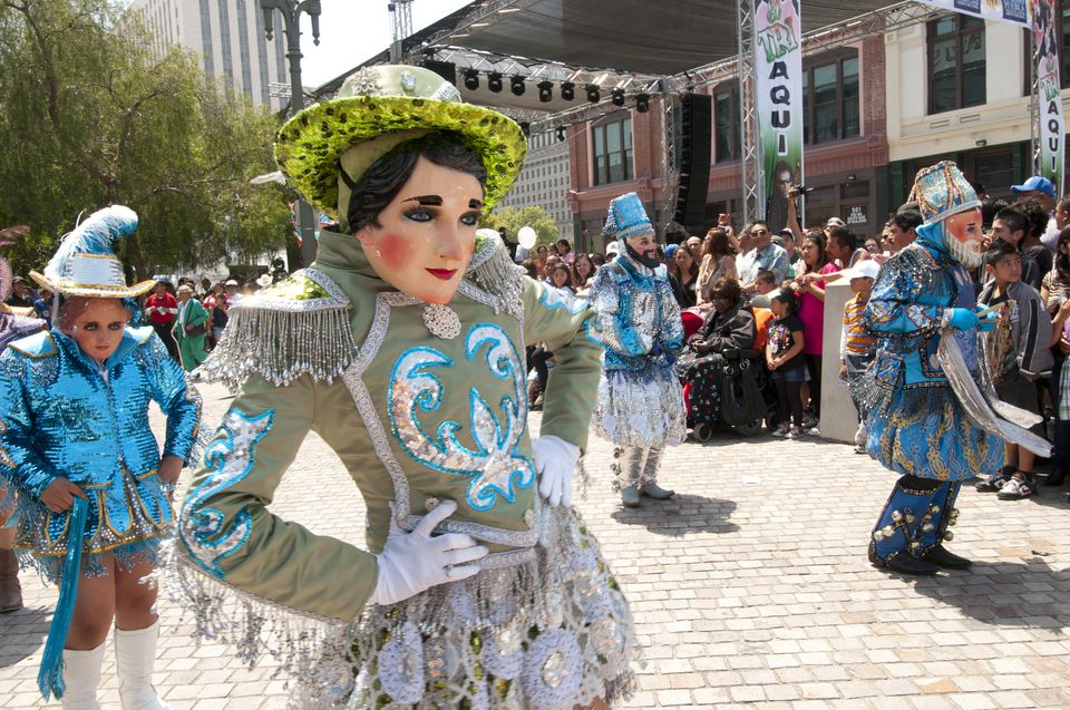 Masked Mexican dancers at Cinco de Mayo celebrations in Los Angeles California USA