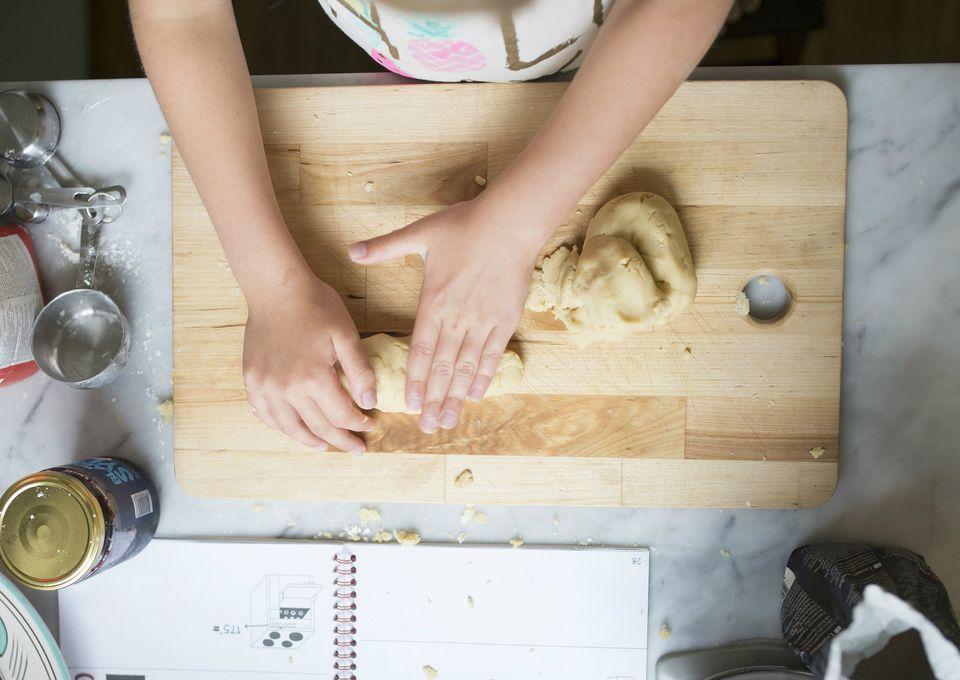 Cropped image of girl making dough