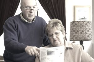 a senior couple reading Social Security form
