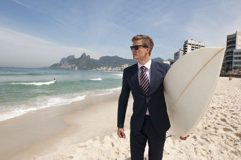 Business man with surfboard in Rio de Janeiro