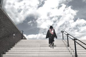 Woman walking up stairs to receive her Masters Degree, North Carolina State University, Raleigh, North Carolina