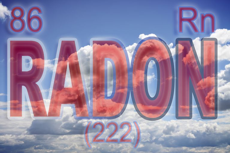 radon sign over blue sky with clouds
