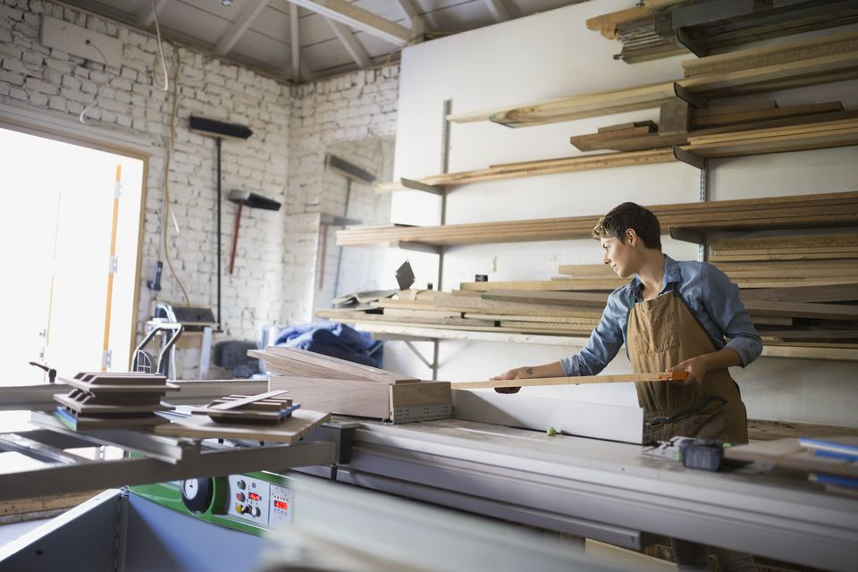 Carpenter selecting lumber