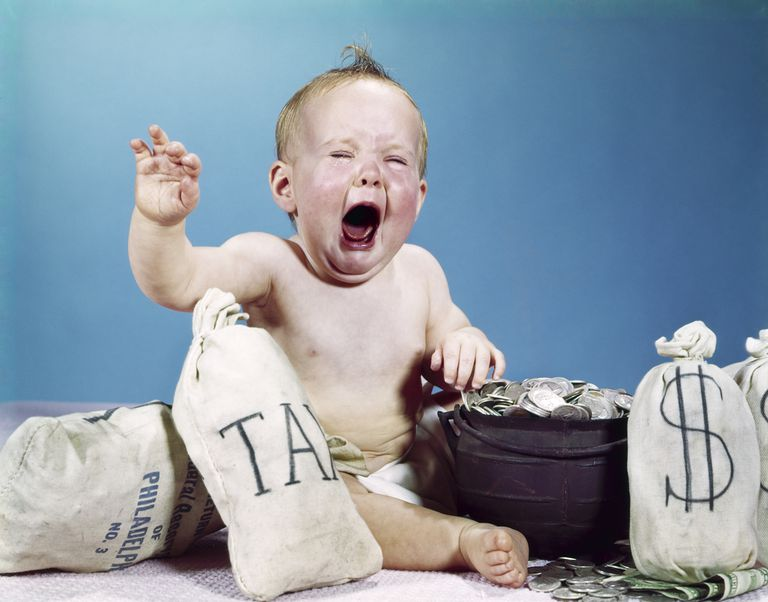 Crying Baby Surrounded by Money