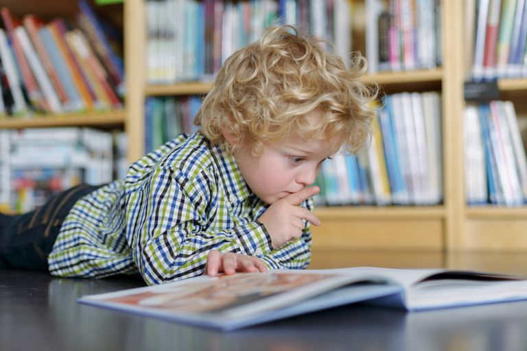 A boy reads in a library.