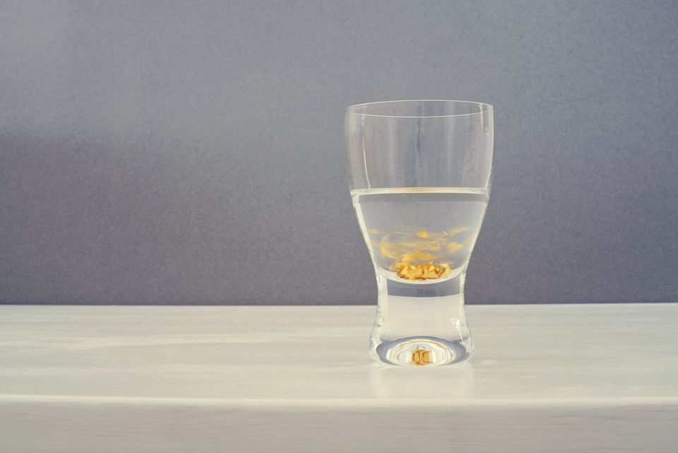 Shot glass with swirling gold flakes
