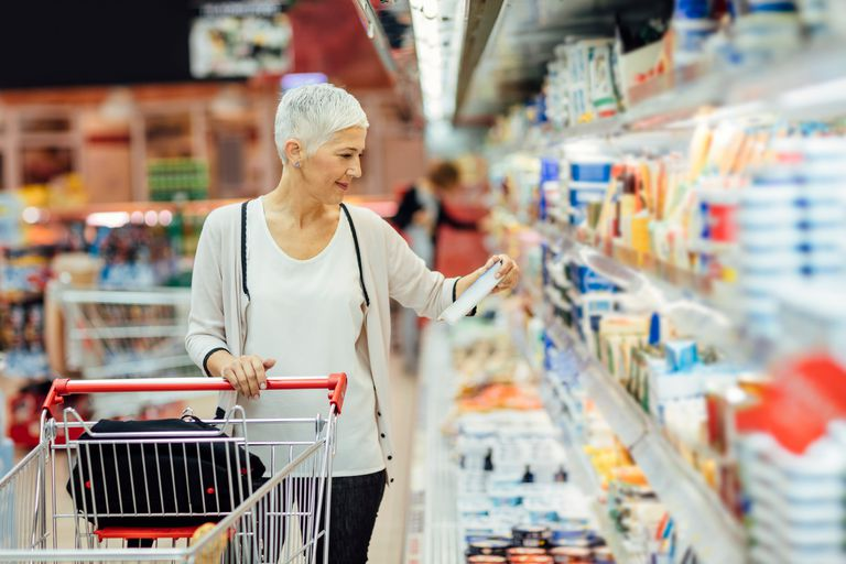 Woman reading nutrition label