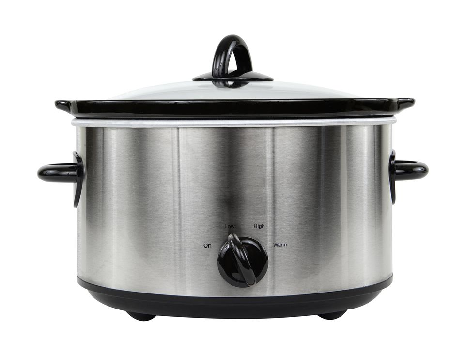 Photograph of silver crockpot isolated on white background