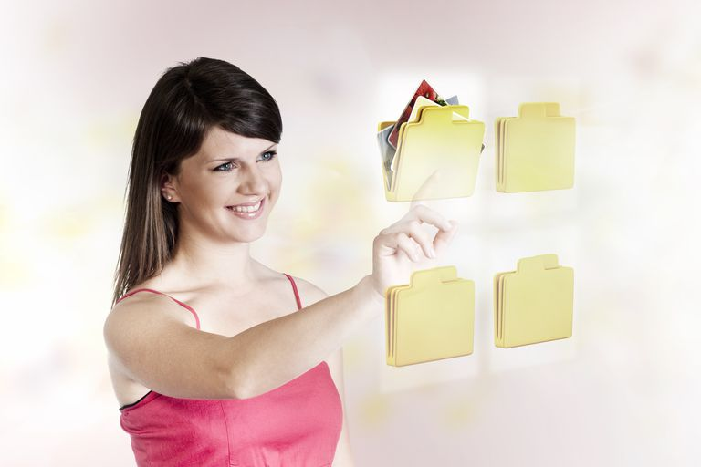 Woman selecting a virtual folder