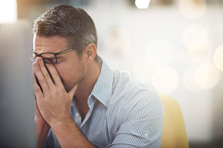 stressed man with head in hands