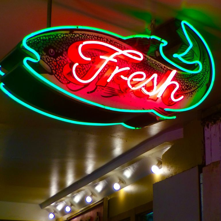 Neon sign for market selling fresh fish
