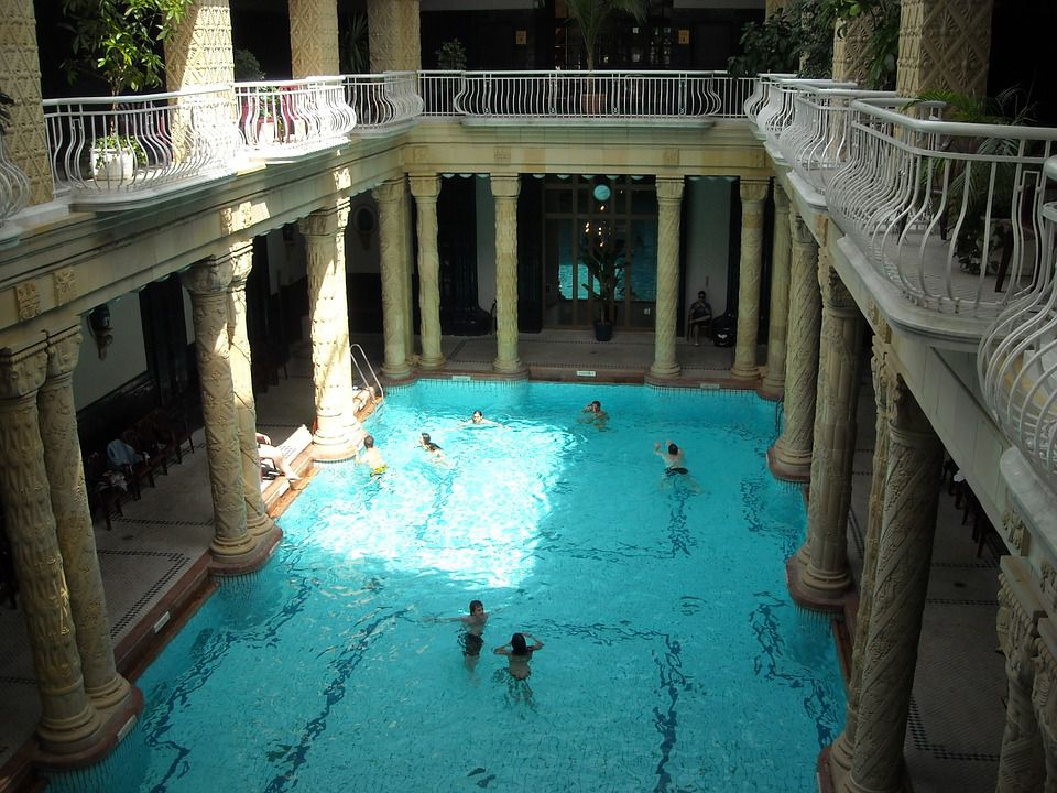 Kids swimming in a hotel pool.