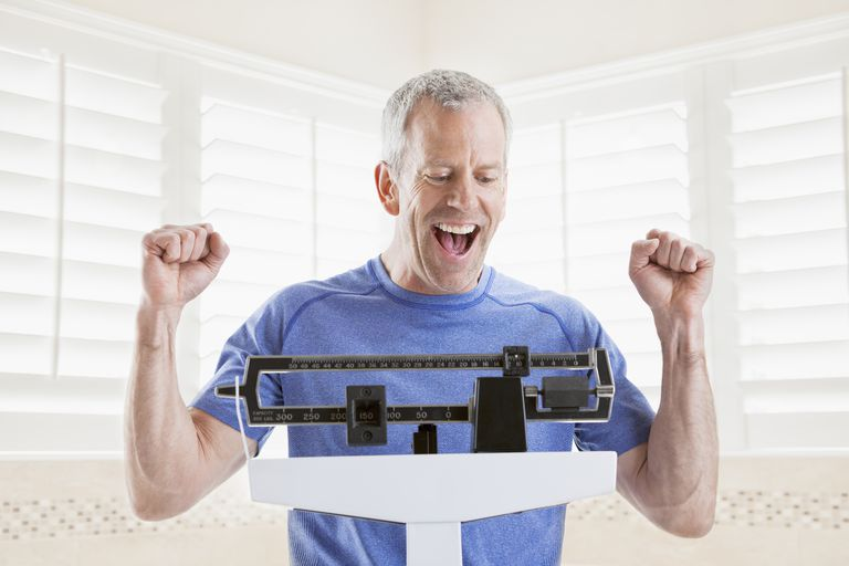 Man weighing himself
