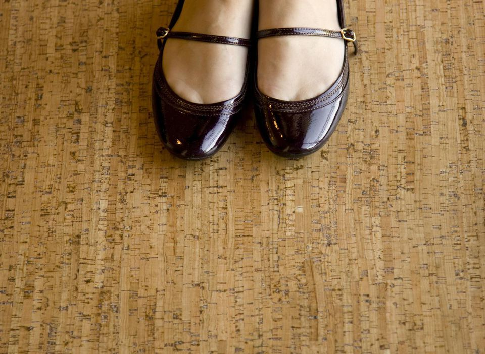 Young woman's feet on a cork floor