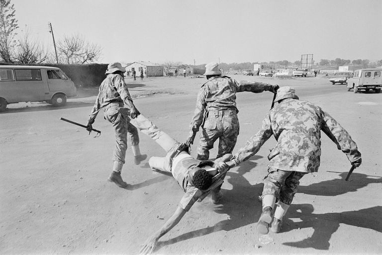 Police Dragging Protestor at Anti-Apartheid Demonstrations in Soweto