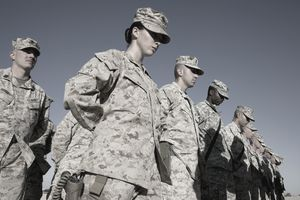 A female marine in a line of soldiers