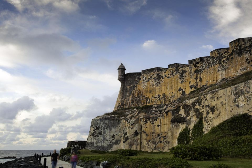 Old walls of El Morro in late afternoon light with blue sky, Old San Juan, Puerto Rico
