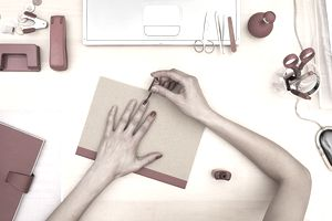 Woman painting her nails at her desk