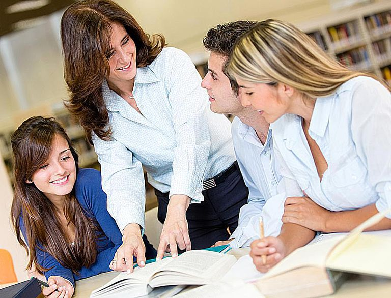 Teaching assistants help teachers by completing housekeeping tasks and helping students as needed.