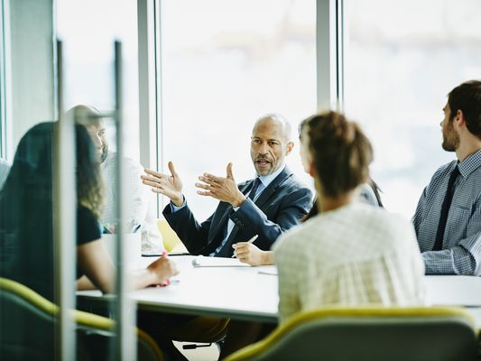 Business executives in conference room
