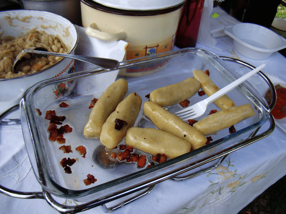 Knedle or Kluski (in Galicia) with fried bacon from Poland