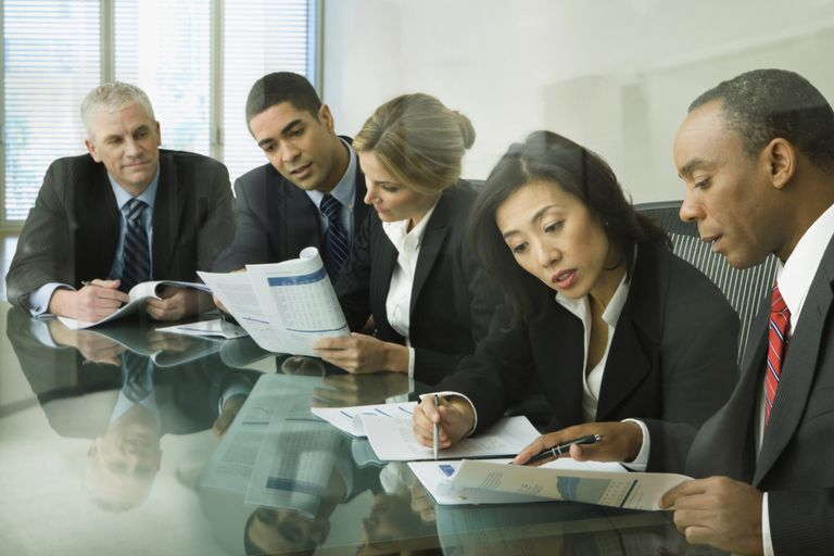 Men and women employees participate seriously in strategic planning to avoid common problems and pitfalls.