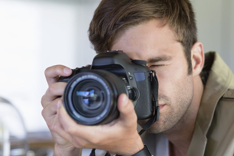 Man photographing with his camera