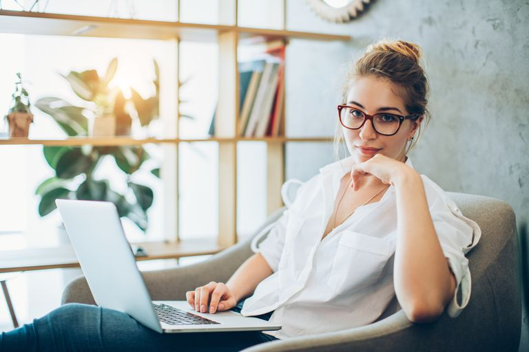 Young beautiful woman working in an alternative office