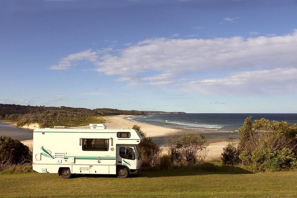 Motorhome parked beside entrance to Burrill Lake, New South Wales, Australia