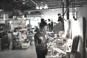 Female small business owner craftswoman working in workshop