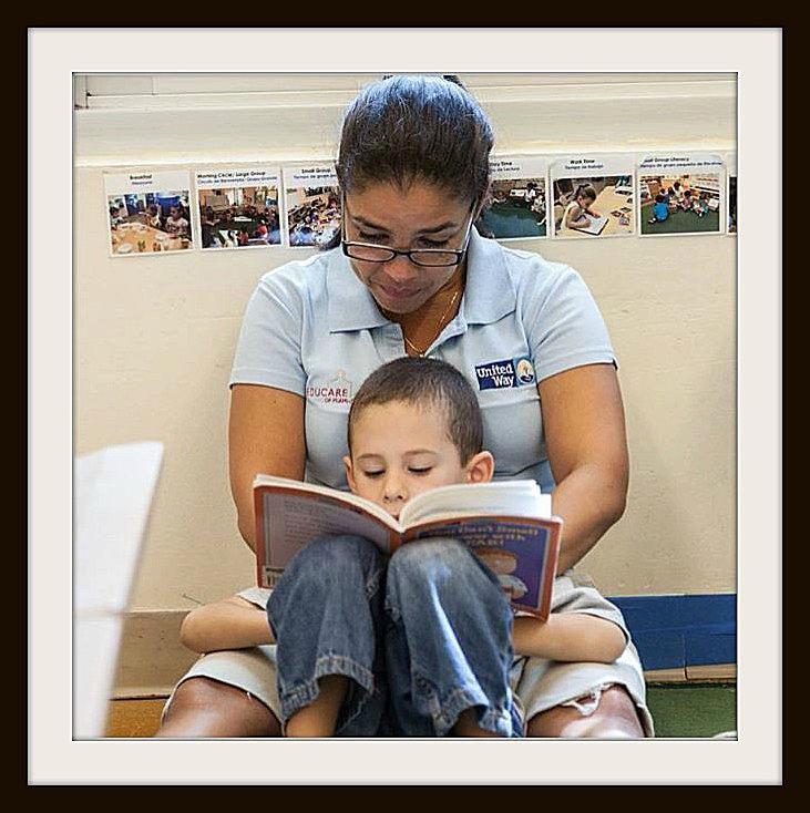 United Way volunteers with child.